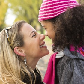 Carer and Child Smiling Together