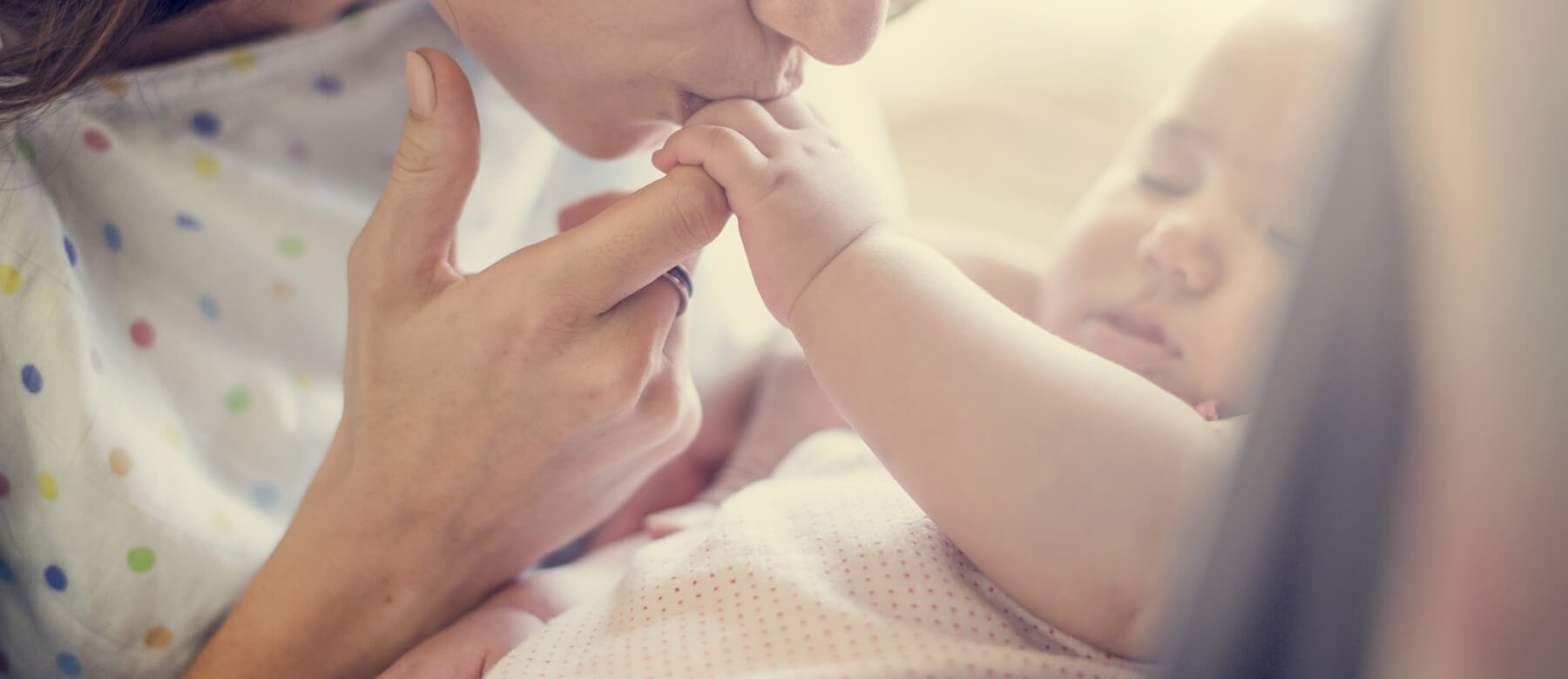 Mother Kissing Baby's Hand
