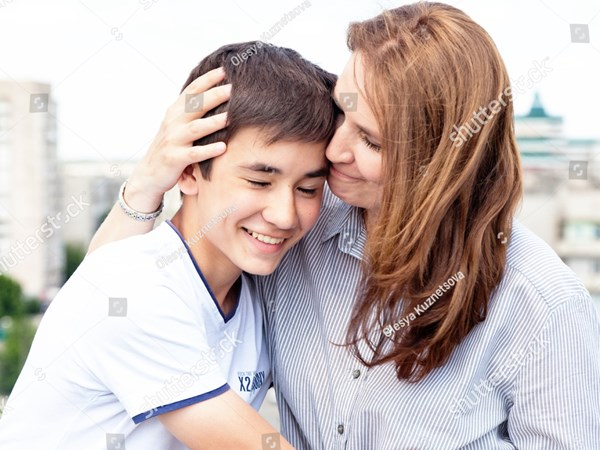 stock-photo-portrait-of-a-mother-with-her-son-teenager-tenderness-love-multinational-family-451039048.jpg