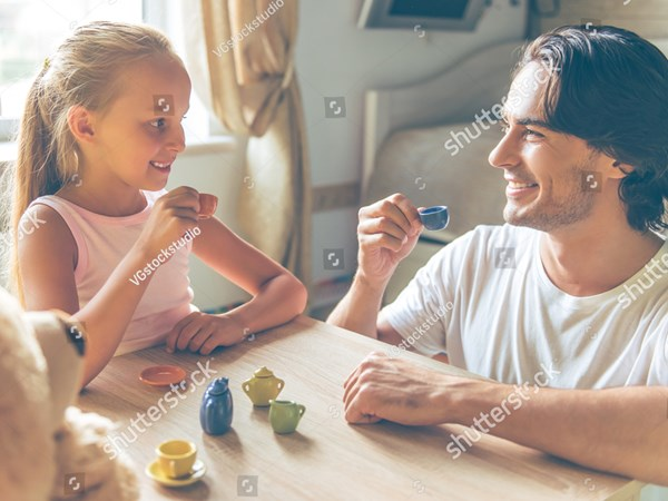 stock-photo-cute-little-girl-and-her-handsome-father-are-holding-little-toy-cups-looking-at-each-other-and-464829494.jpg